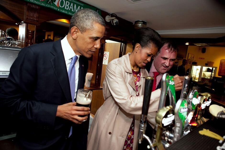 Michelle Obama pours a Guinness
