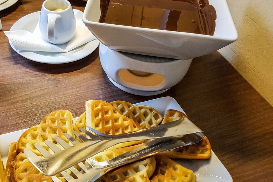 Waffles with chocolate sauce - perfect for an American breakfast with Eggs Benedict and waffles