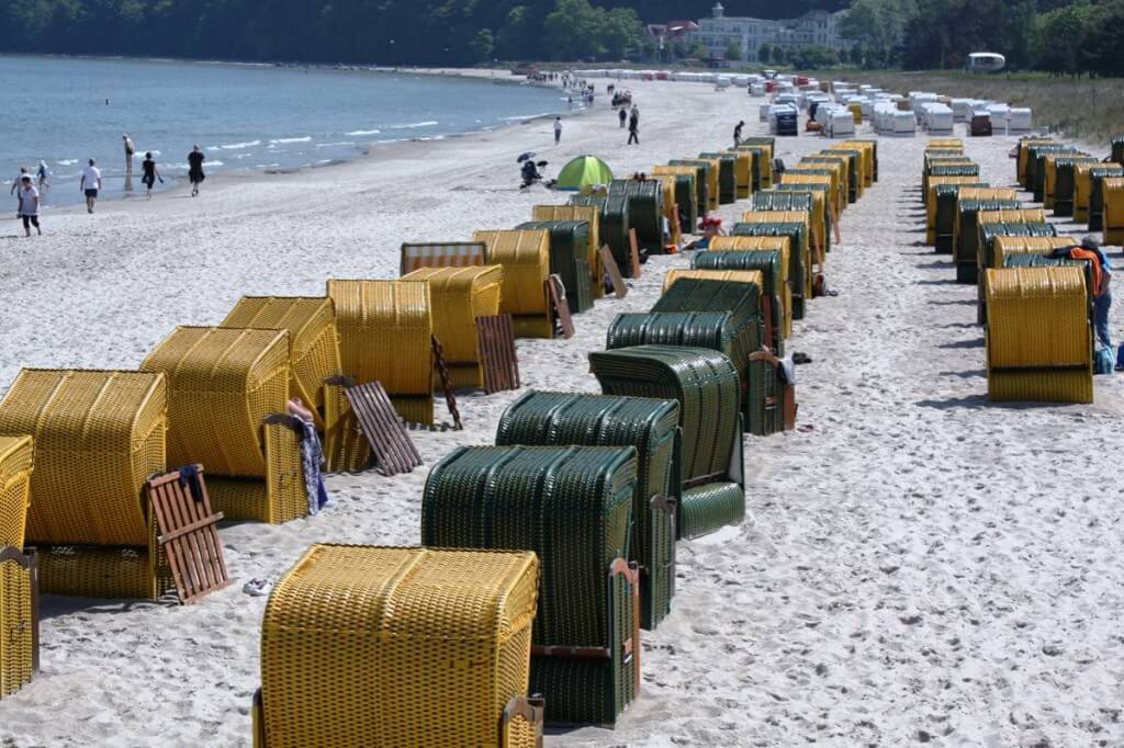 Beach chairs in yellow and green on the beach in the seaside resort of Binz