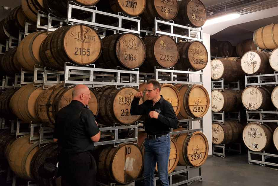 Petar talks to our guide at the whiskey distillery St. Kilian