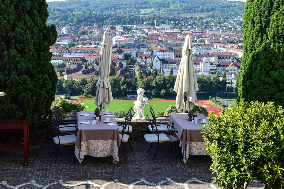 Breakfast terrace with a view of the city from the Weinberg Hotel Würzburg