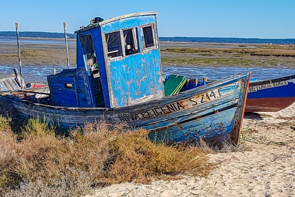 Discarded boats on the Rota do Peixe, the fishing path Portugal