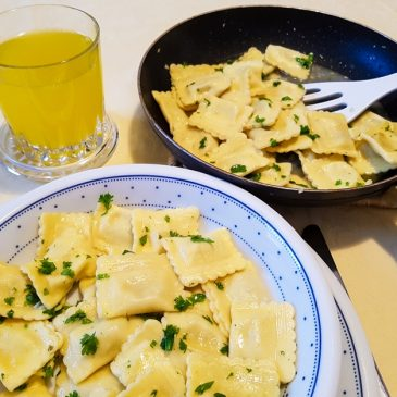 Cep ravioli with garlic butter sauce