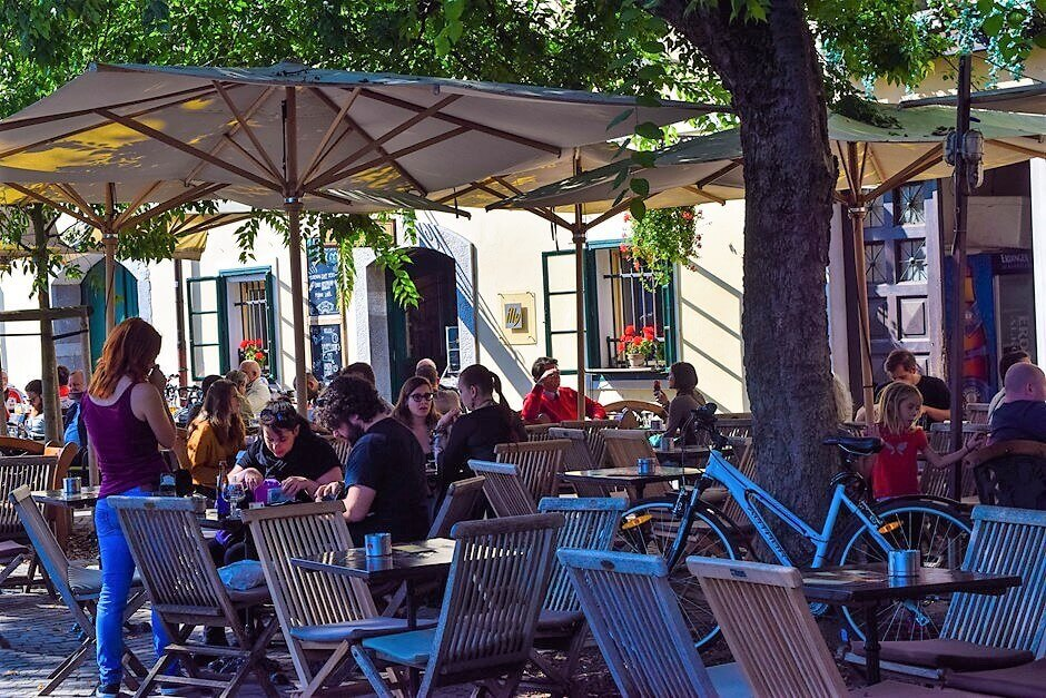 Restaurants and cafes in Ljubljana on the riverside - culinary trips in Slovenia