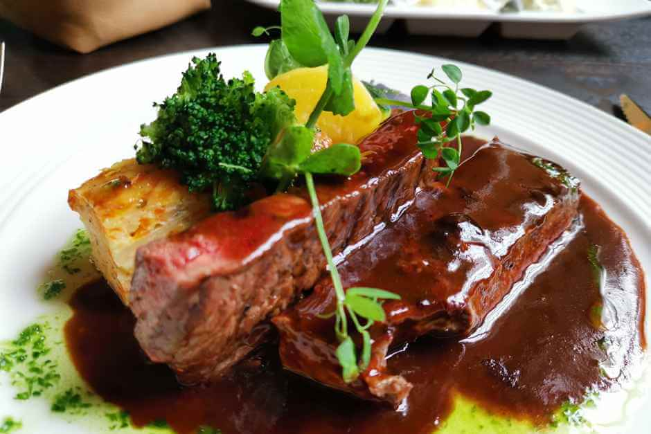 Steak in red wine sauce with potato gratin