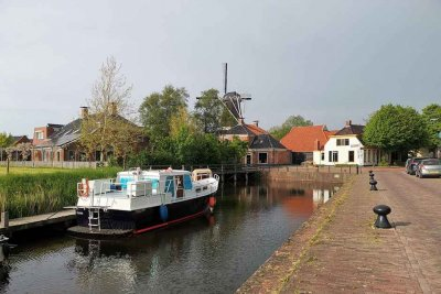 Canal, houseboats and windmill