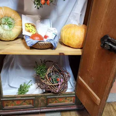 Old rustic cabinet with autumn decoration