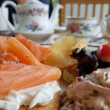 Typical Scottish food and drink - salmon rolls with tea